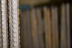 Metal reinforcing bar. Two pieces of metal reinforcing bar or rebar with a blurred background Stock Photos