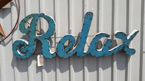 Metal Relax Sign in A Turquoise finish Tack welded Stock Images