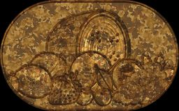 Metal relief plate fruit symbols Royalty Free Stock Photography