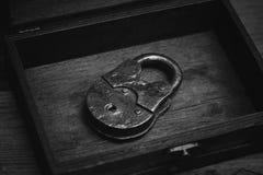 Metal retro padlock on wooden background Stock Photo
