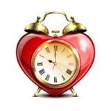Metal retro style alarm clock in heart form. Stock Photo