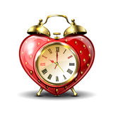 Metal retro style alarm clock in strawberry form. Royalty Free Stock Photography