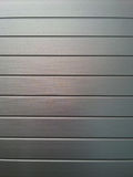 Metal Ridges. A ribbed, gray metal background Stock Photos