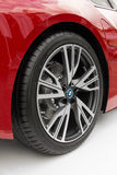 Metal rim on a red BMW sports car. JUNE, 2016, BUDAPEST, HUNGARY - Metal rim on the red BMW sports car isolated on white background Royalty Free Stock Photography