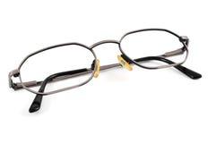 Metal-rimmed eyeglasses. Closeup of a pair of metal-rimmed eyeglasses on a white background Stock Photo