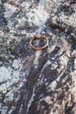 Metal ring climbing equipment. At stone cliff Royalty Free Stock Photo