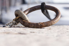 Metal ring in a dock with attached rope Stock Image