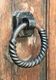 Old door knocker. Metal ring door knocker on a medieval wooden door Stock Photos