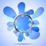 Metal ring over the blue blots Stock Images