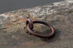 Metal Ring on Towpath. A small rusty metal ring on the towpath of a canal Stock Photos