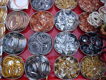 Metal rings and bangles at street market. In India royalty free stock photography