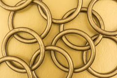 Metal rings on a golden background Royalty Free Stock Images