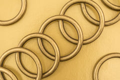 Metal rings on a golden background Royalty Free Stock Photography