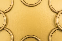 Metal rings on a golden background Royalty Free Stock Photo