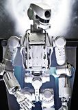 Metal robot on space background royalty free stock photography