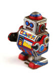 Metal robot. Metal windup robot in blue, silver, red and yellow Royalty Free Stock Photo