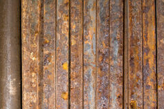 Metal rod rusty. Rusty metal square rod background Stock Image