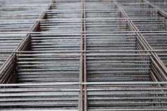 Metal rods stacked in piles Royalty Free Stock Photography