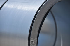 Metal roll. Silver metal roll in close-up royalty free stock image