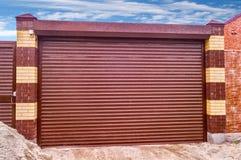 Metal roll up door. Brown color Royalty Free Stock Photo