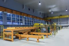 Metal rolling shop yellow in the gray shop. Metal rolling conveyor royalty free stock photos