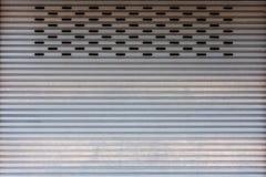 Metal rolling shutter door Stock Images