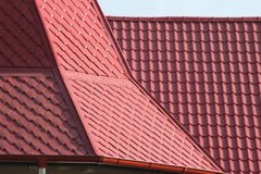 Metal roof. Tilled red metal roof detail royalty free stock images