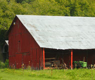 Metal Roof Barn. Old barn with a metal roof and red sides stock photo