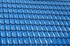 Metal roof of the blue color. Part of the metal roof of the blue color, shadow of morning sunlight royalty free stock photos
