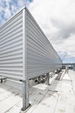 Metal roof enclosure. Roof of a high rise building with a metal air conditioning enclosure royalty free stock photo
