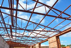 Metal Roof Frame House Construction.  Metal roof-trusses. Stock Photos