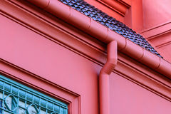 Metal roof gutter in red color Royalty Free Stock Images