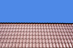 Metal roof of a house over clear blue sky Stock Photography