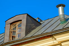 Metal roof with old attic. Royalty Free Stock Photo