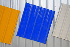 Metal roof painted by silver, blue, yellow color Stock Images