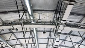Metal roof structures with a vent pipe and spotlights. aluminum profile details Royalty Free Stock Photography