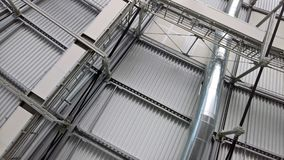 Metal roof structures with a vent pipe and spotlights. aluminum profile details Stock Photography