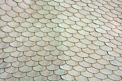 Metal roof tiles. Patina on the shingles. Background beautiful pattern. Royalty Free Stock Photos