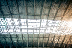 Metal roof at urban terminal with sun shining through windows Stock Images