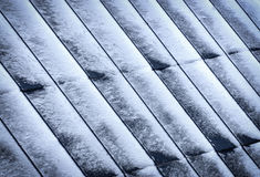Metal roofs of windblown snow Royalty Free Stock Images