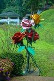 Metal roses. Big metal roses in the garden Stock Image