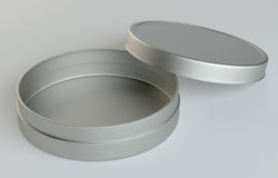 Metal round box on gray background. 3D illustration Stock Images