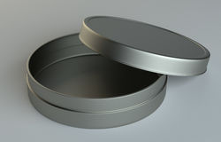 Metal round box on gray background Royalty Free Stock Image