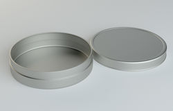 Metal round box on gray background Stock Photos