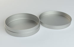 Metal round box on gray background. 3D illustration Stock Photography