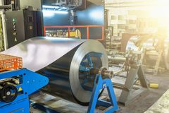 Metal round roll of galvanized stainless steel sheet, industrial metalwork machinery manufacturing stock photography