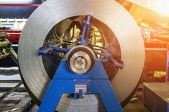 Metal round roll of galvanized stainless steel sheet, industrial metalwork machinery manufacturing royalty free stock photography