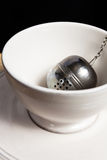 Metal round tea strainer on the chain Stock Images