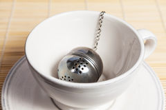 Metal round tea strainer on the chain Royalty Free Stock Image