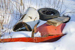 Metal and rubber pollution on winter snow Stock Photo